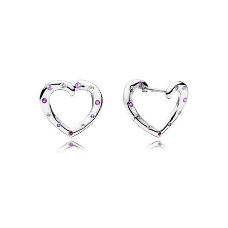 A pair of silver heart earrings by Pandora Jewelry here in Santa Fe.