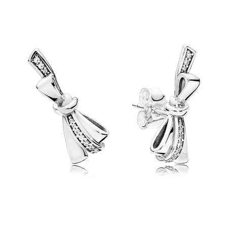 A pair of bow stud silver earrings by Pandora here in Santa Fe.