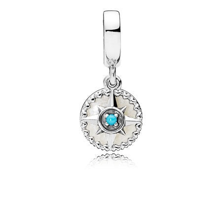 A compass rose dangle charm by Pandora with blue crystal