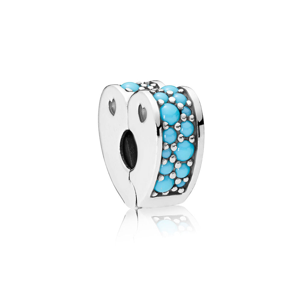 A Pandora charm shaped like a heart with turquoise.
