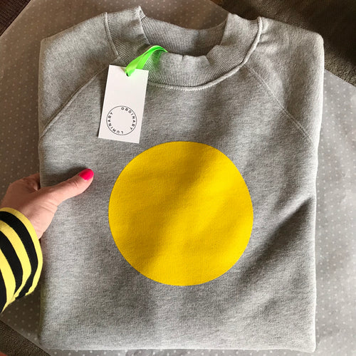 Bright yellow circle on light grey relaxed sweatshirt — Ordinary Luminary