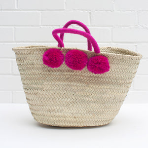 Pom pom basket in fuschia pink | ethically made in Morocco — Ordinary Luminary