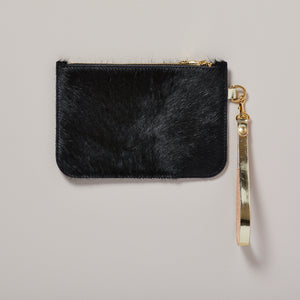 Cowhide clutch bag in black with gold wristlet | handmade clutch bag — Ordinary Luminary