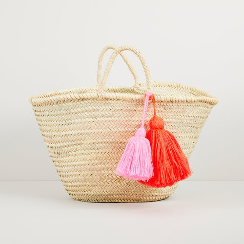 Medium tassel basket in bright orange and fuchsia pink | ethically handmade in Morocco — Ordinary Luminary