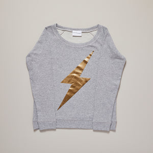Metallic gold lightning bolt on light grey sweatshirt — Ordinary Luminary