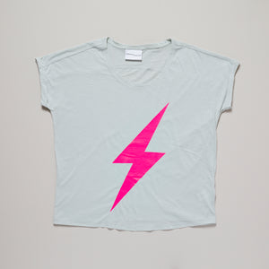Neon pink lightning bolt on light green loose fit t-shirt — Ordinary Luminary