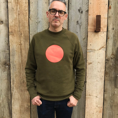 Neon orange circle on khaki relaxed fit sweatshirt — Ordinary Luminary