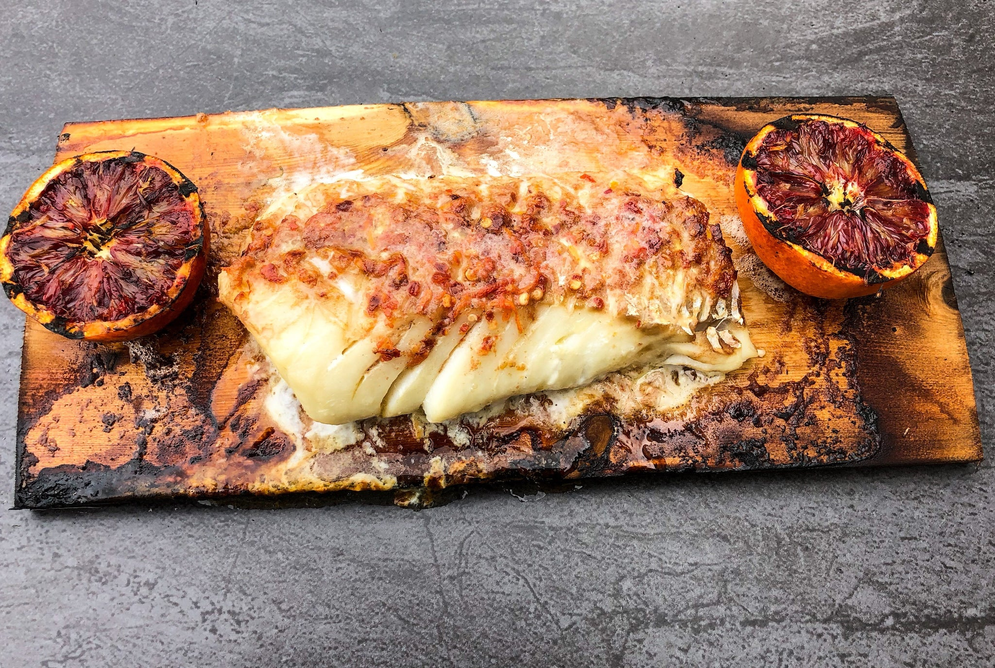 Cod fillet with Red Pepper-Blood Orange Butter on Chardonnay infused Cedar Plank