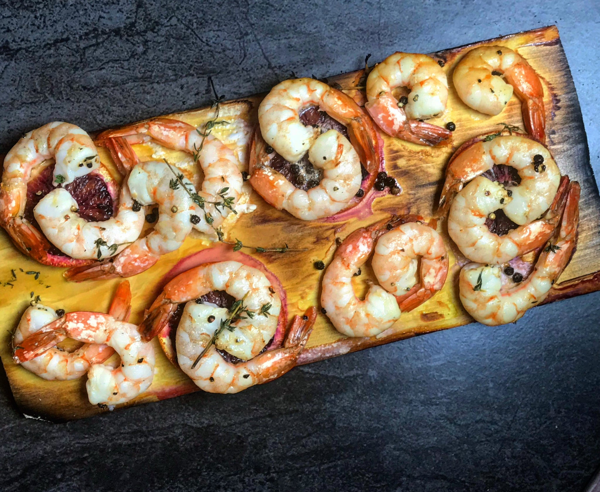 Chardonnay Infused Cedar Planked Shrimps with Blood Orange and Peppercorns