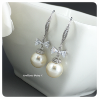 Swarovski White Pearl with CZ Ribbon Dangle Earrings
