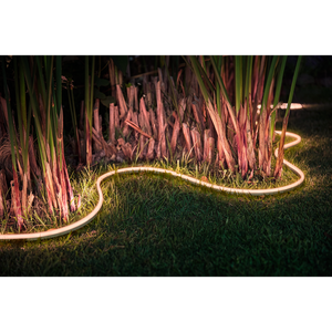 Philips Hue Outdoor Lightstrip outdoor in palms on grass