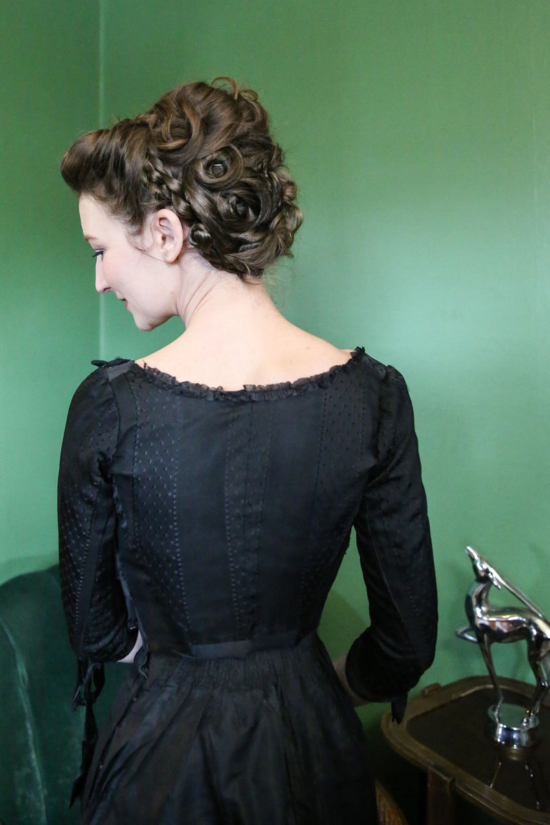 Early 1900s Sophisticated Pigeon Breasted Blouse in Black Silk Brocade