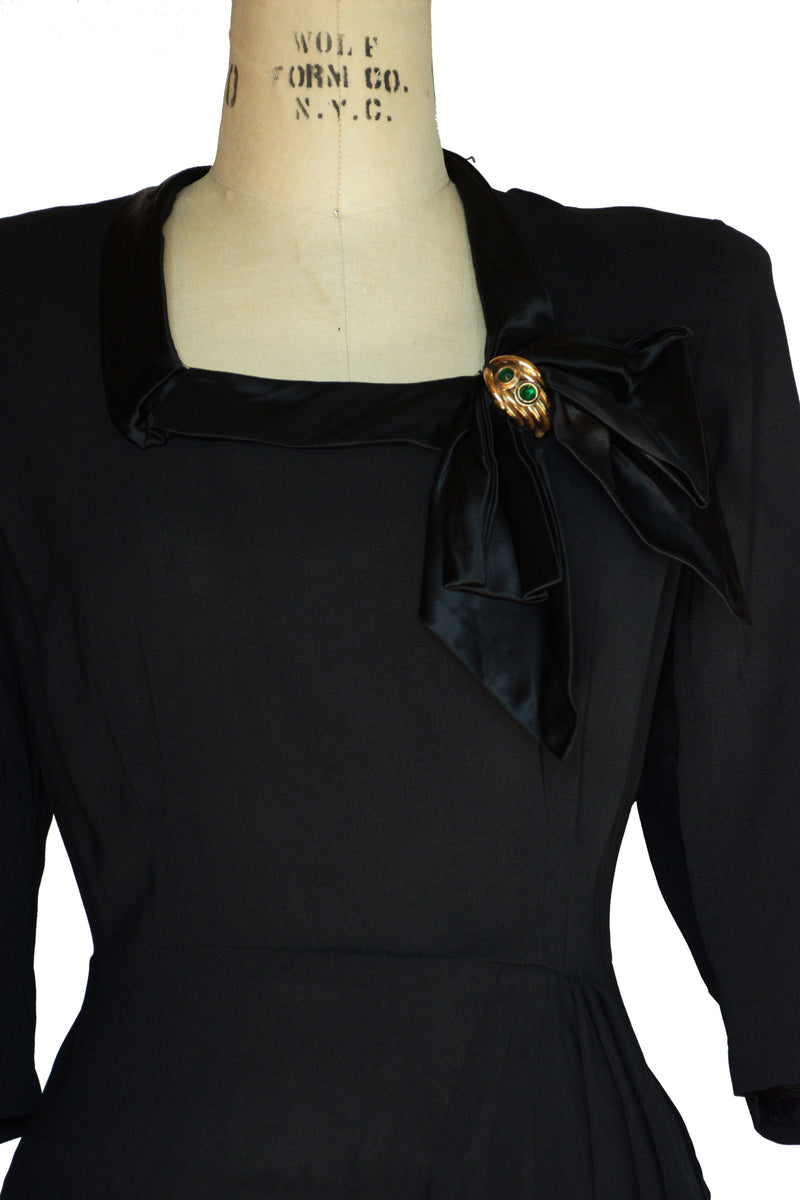 Saucy 1940s Postwar Black Rayon Cocktail Dress with Satin Neckline and Draped Skirt from Young Viewpoint Fashions