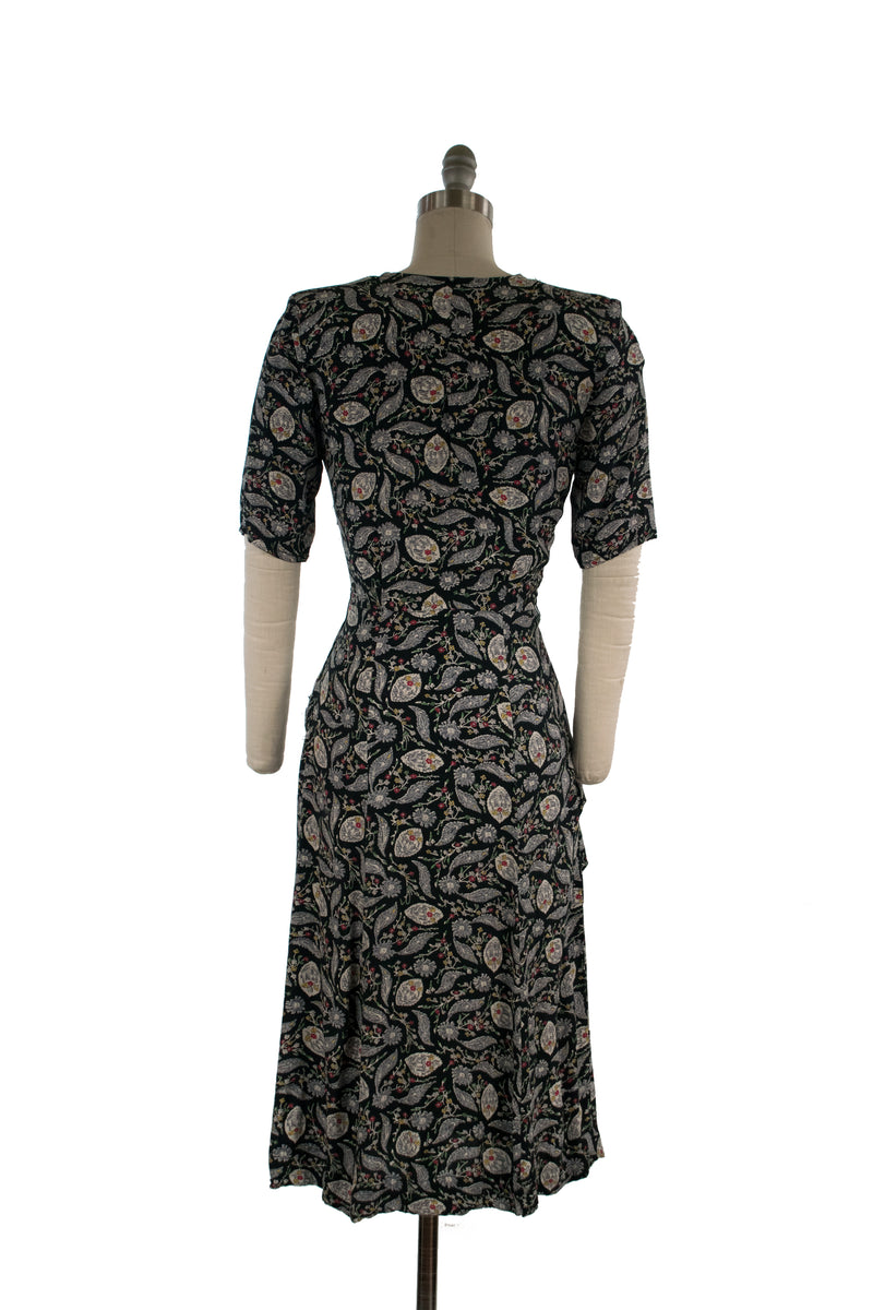 Charming 1940s Rayon Dress with Folkwear Inspired Floral Print and Asymmetric Peplum