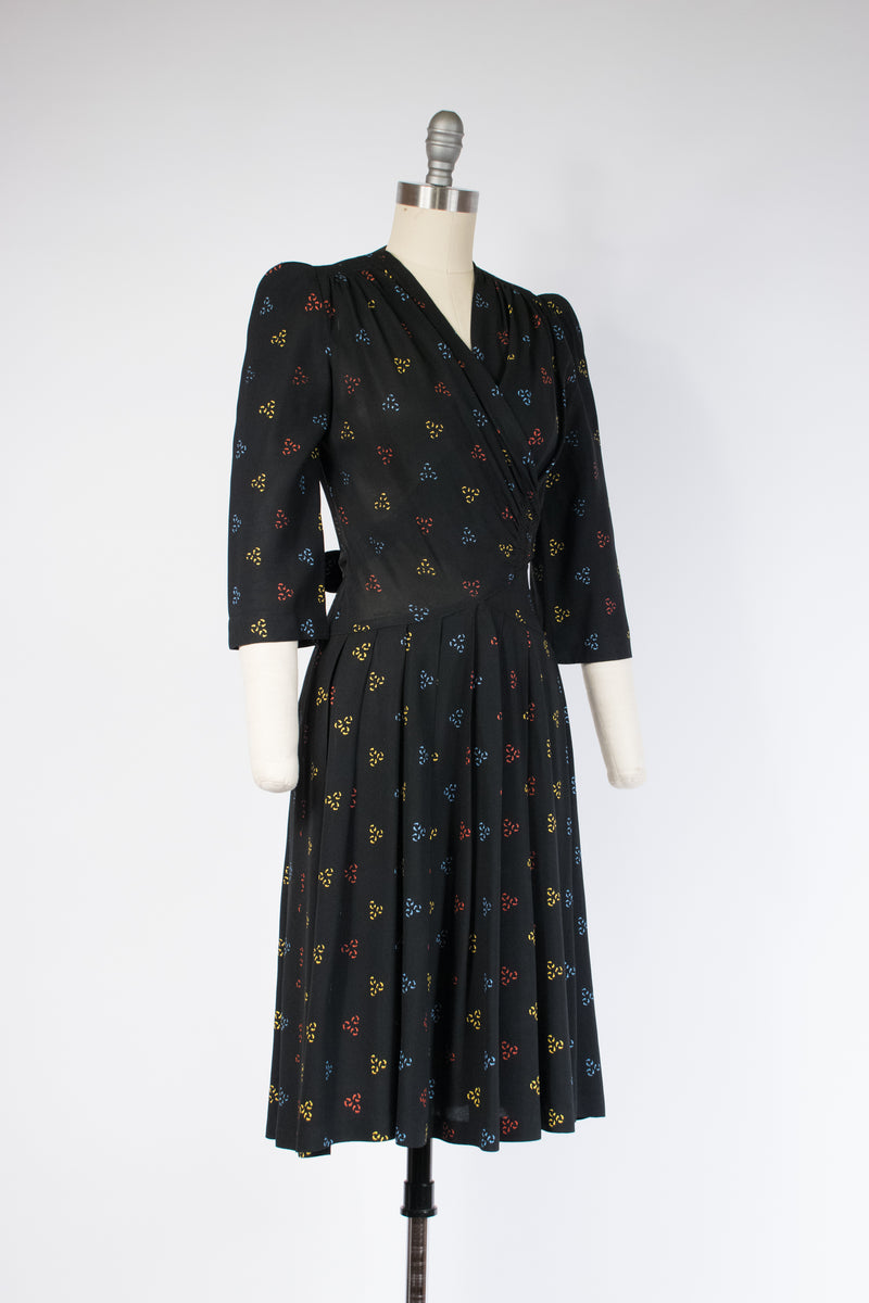Tailored Late 1930s Black Rayon Dress in Screen Print in Primary Colors and Faux Wrap
