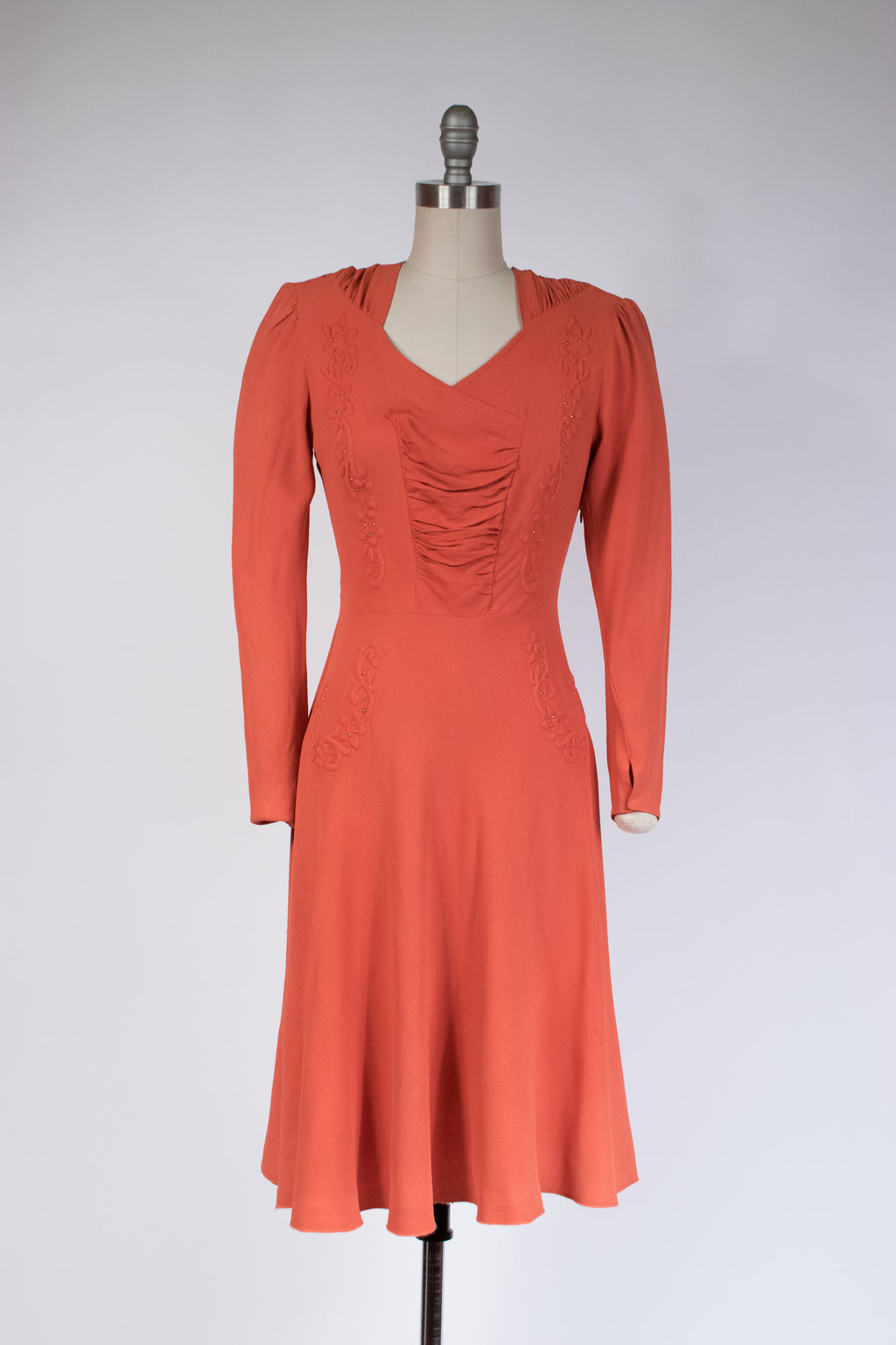 Striking Late 1930s Coral Dress with Trapunto Work and Brass Studs