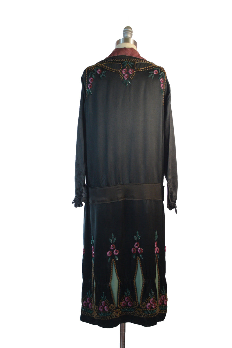 Exquisite 1920s Beaded Dress in Black Silk Charmeuse with Contrast Keyhole Cutaways and Colorful Floral Motifs