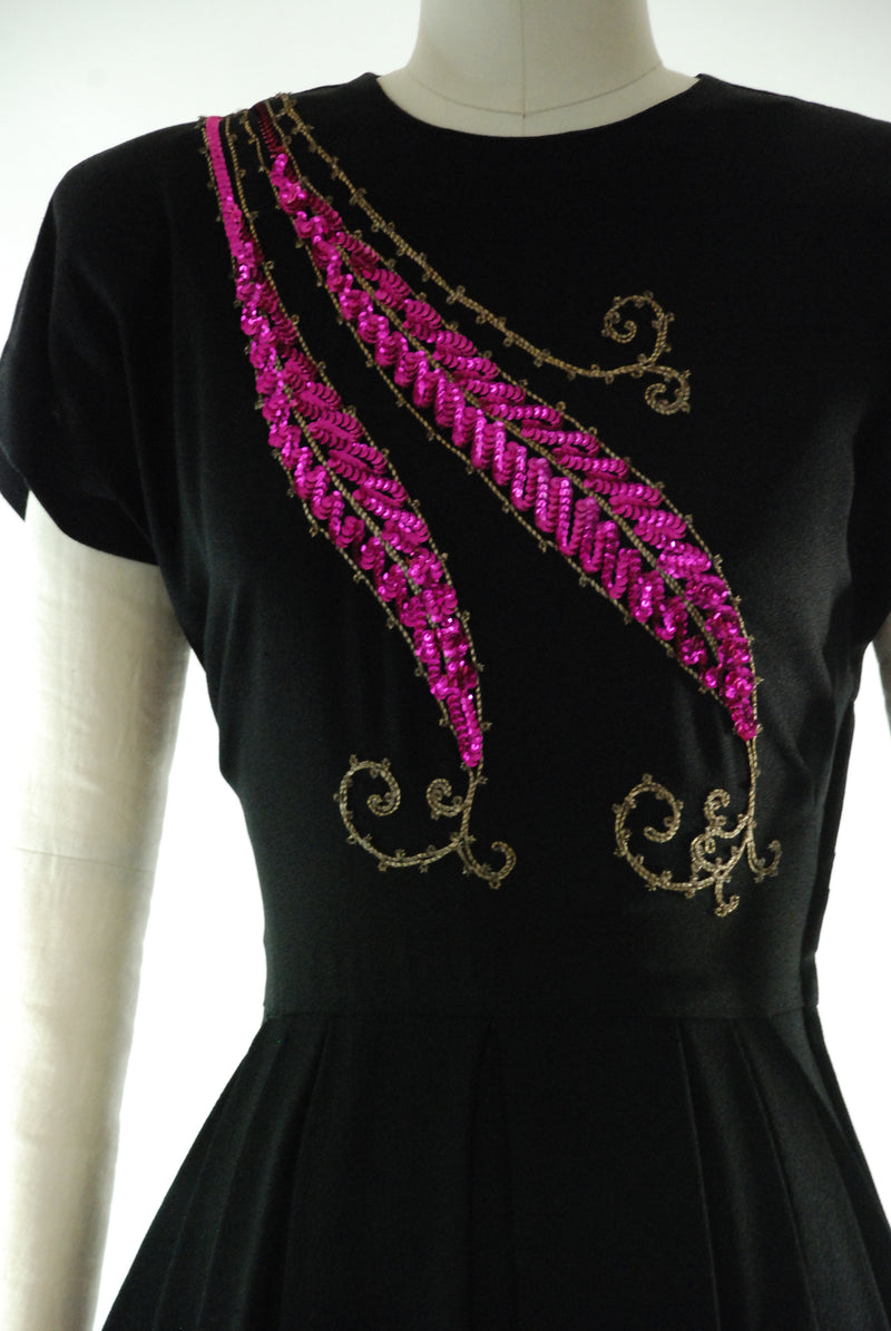 RESERVED ON LAYAWAY Vintage 1940s Evening Gown in Black Rayon Crepe with Fuchsia Feather-Leaf Motif Sequins and Dramatic Hip Draping