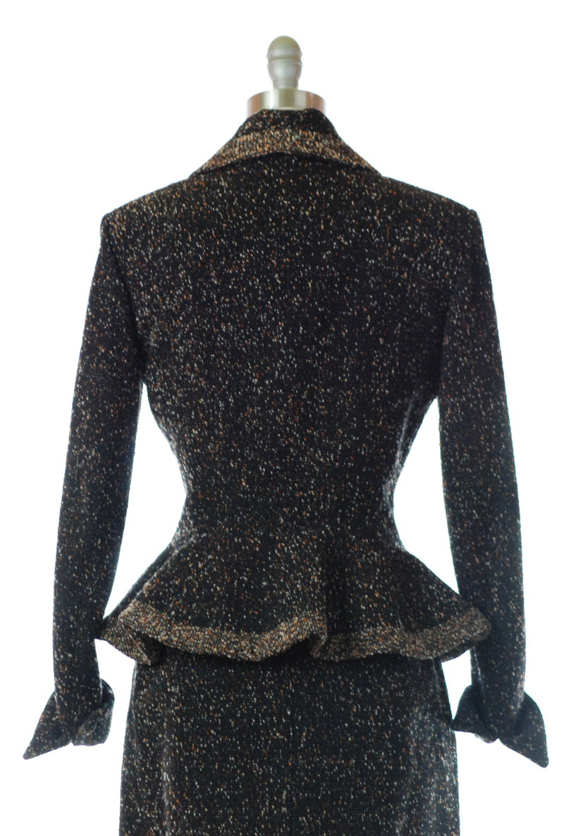 Glorious 1950s Lilli Ann Suit in Flecked Wool with Flared Peplum