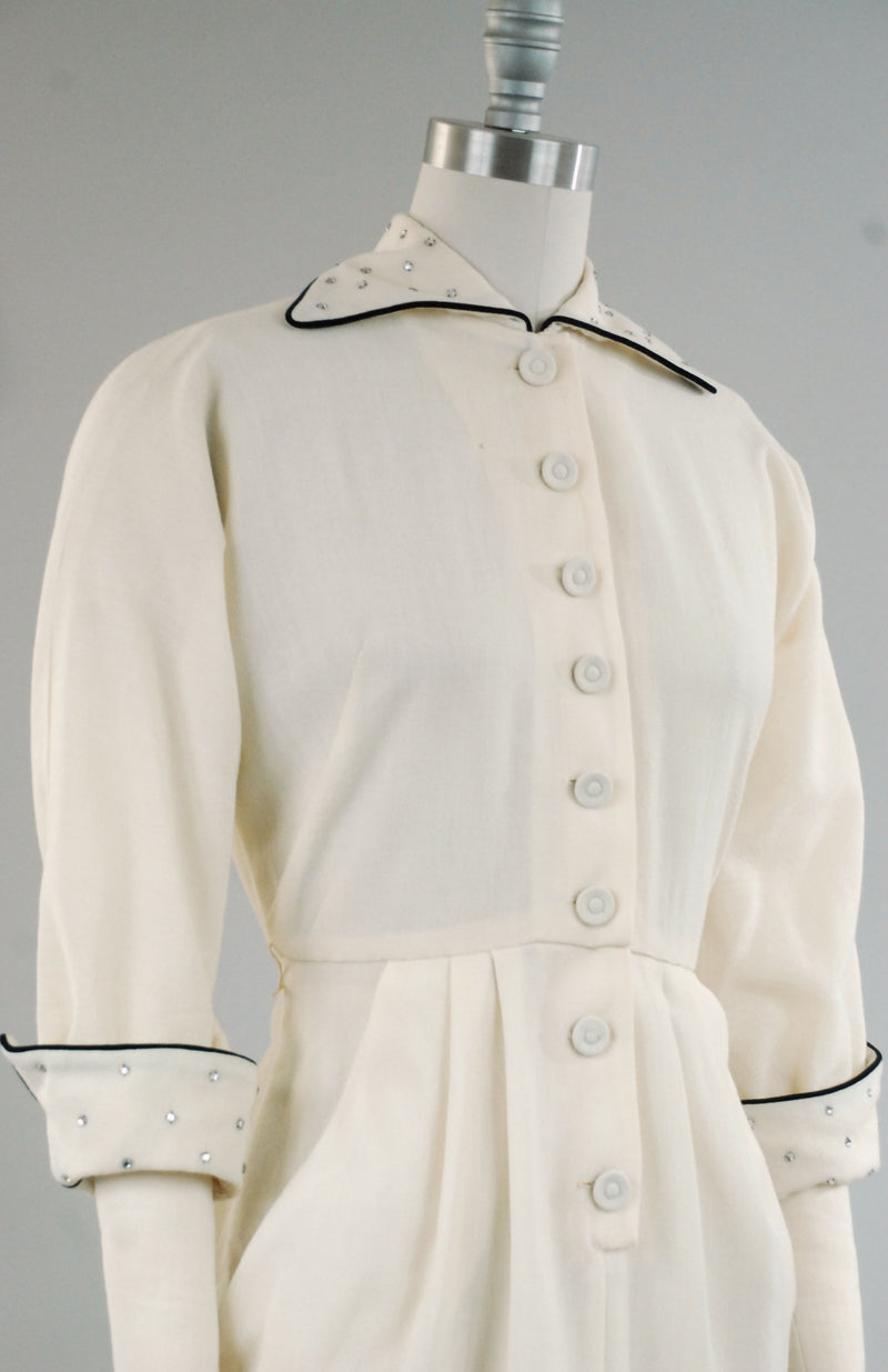 Smart 1950s Tailored Day Dress of Ivory Wool Crepe with Black Trim