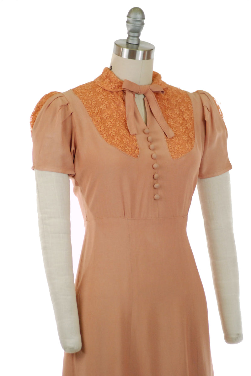 Charming 1930s Puffed Sleeve Dress of Peach Rayon with Tambour Lace Trim