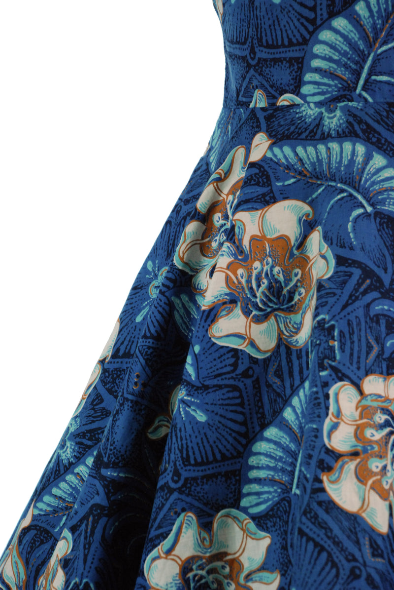 Gorgeous 1950s Hawaiian Tiki Dress with Full Skirt and Underbust Halter in Blue