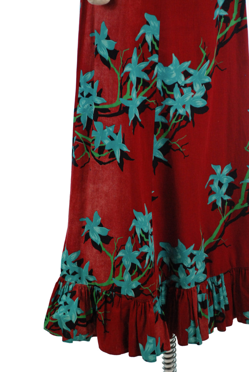 Beautiful Late 1950s Malihini Hawaiian Holomuu Dress in Wine Red with Turquoise Star Flowers