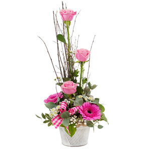 Pink colour Roses and gerbera flower arrangement with greenery.