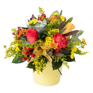 Yellow, orange, red colour flowers flower arrangement in a tin