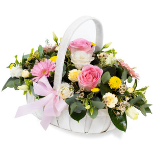 Pink, White colour rose, gerbera with mix flower arrangement in a basket.