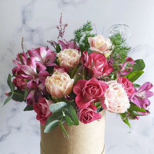 Tulip, Spray Roses and Alstro flowers hand delivered in Hat Box.