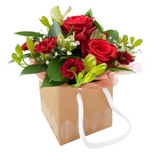 Red colour Roses with white colour flowers and greenery.
