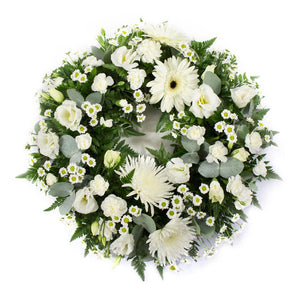 Ring wreath for a funeral in creams.