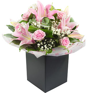 A beautiful combination of pink lilies and roses