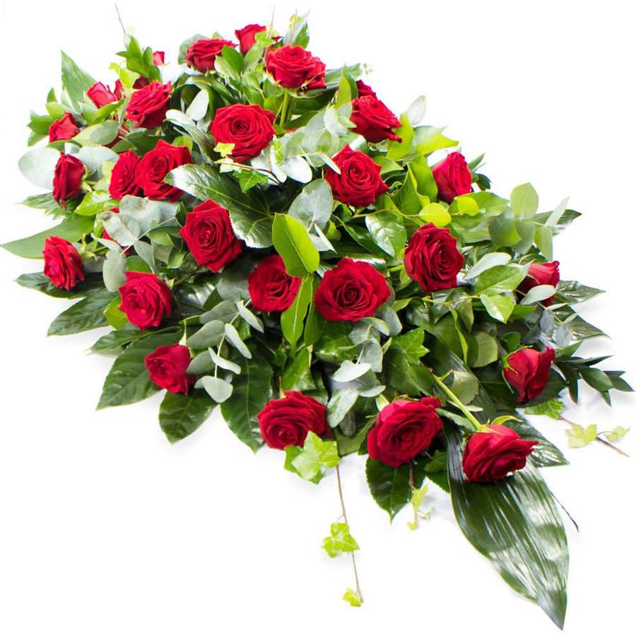 A beautiful funeral tribute made with deluxe red roses