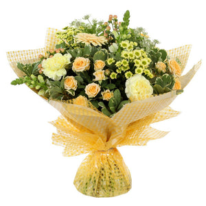A warm collection of seasonal flowers artistically arranged by an artistic florist.