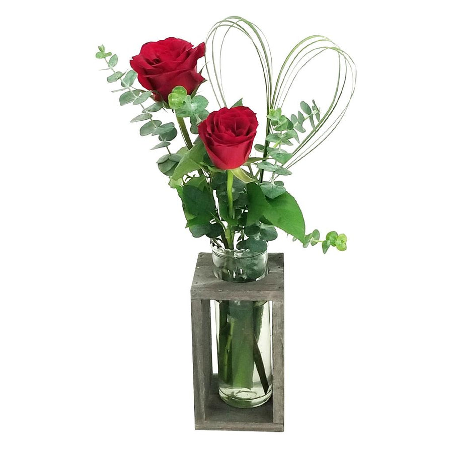 2 Stems of Roses arranged in a modern wood glass vase.