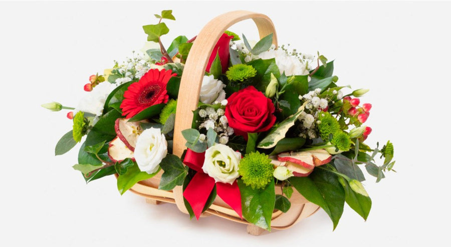 Rudolph red flowers complemented with an array of festive green foliage