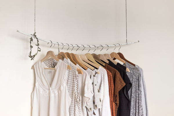 Wooden hangers displaying clothes
