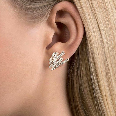 Cygnus earrings on model (closeup)