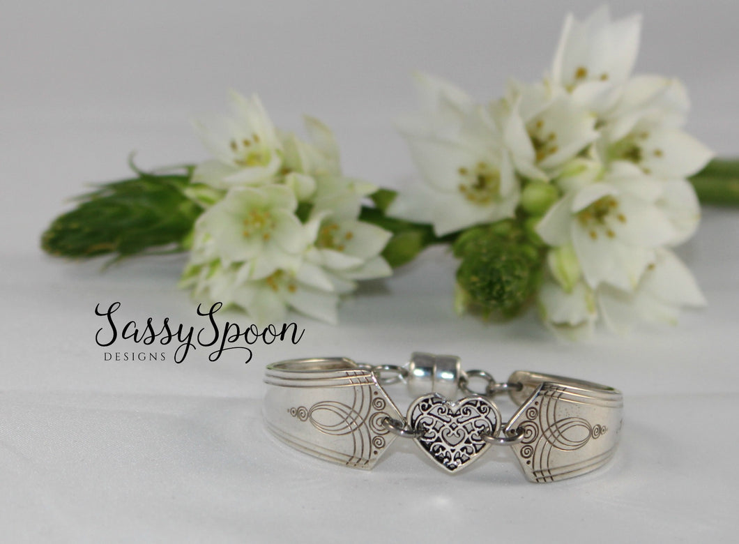 Handcrafted Silverware Bracelet with a Charm Connector