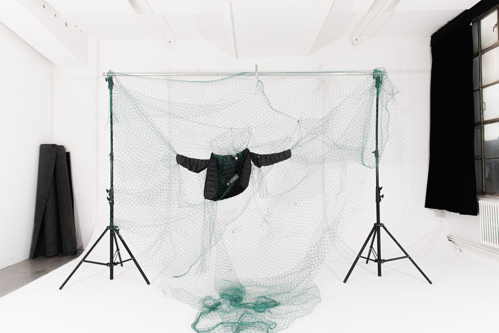 Jacket hanging in fishing net