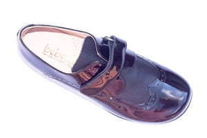Boys black patent slip on brogue with velcro closure. Dress/classic shoes perfect for wedding, page boy, Bar-Mitzvah.  Made in Spain by Beberlis from genuine leather and first class materials.