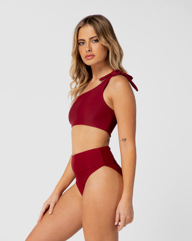 Tulum Pomegranate Red Bikini One-Shoulder Top Blonde Australian Sustainable Swimwear Recycled Plastic Beachwear