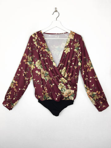 c85ef57cde1b3c What About This - Serena Maroon Floral Wrap Front Bodysuit