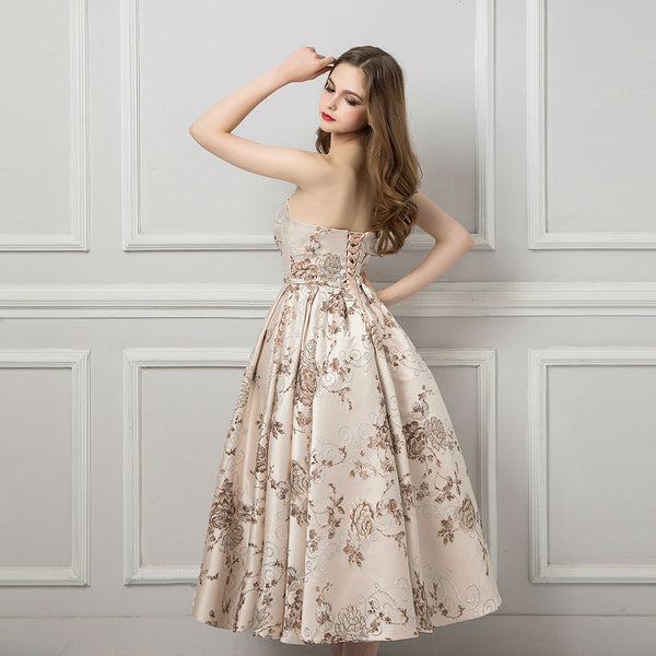 "<p style=""font-size: 18px;""><b>ANNABELLE</b></p><p style=""color:grey"">FLORAL EMBROIDERED STRAPLESS GOWN</p>"