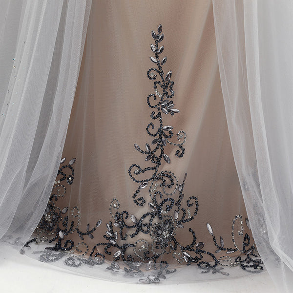 "<p style=""font-size: 18px;""><b>BELLA</b></p><p style=""color:grey"">MULTI BEADED BACKLESS CAPE GOWN</p>"