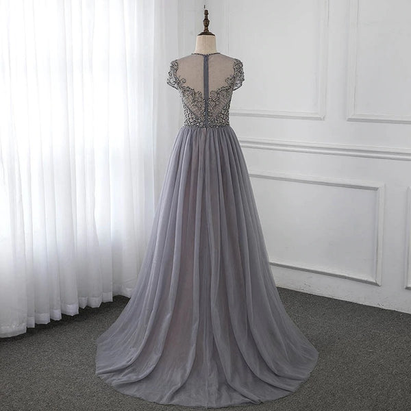 "<p style=""font-size: 18px;""><b>CAMELIA</b></p><p style=""color:grey"">CRYSTAL BEADED FLORAL CAPE GOWN-CHAMPAGNE/GREY</p>"