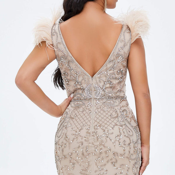 "<p style=""font-size: 18px;""><b>CASSANDRA</b></p><p style=""color:grey"">CHAMPAGNE FEATHER & CRYSTAL BEADED MERMAID GOWN</p>"