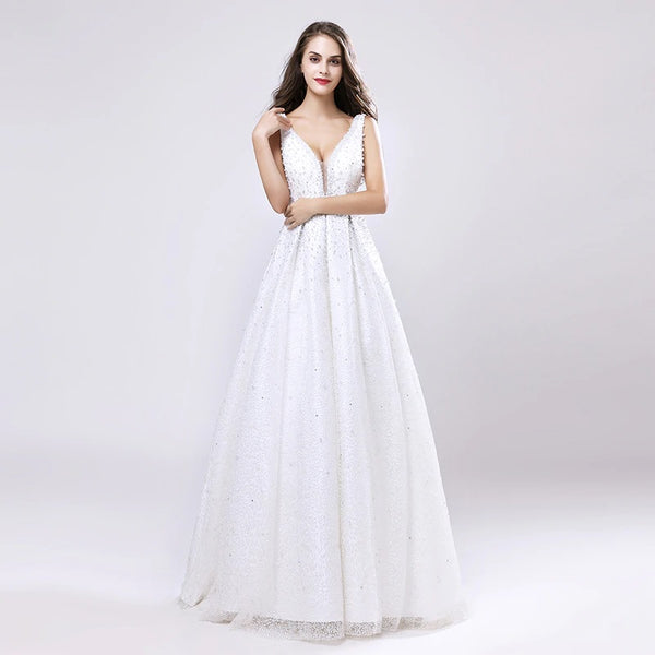 "<p style=""font-size: 18px;""><b>CELINE</b></p><p style=""color:grey"">PEARL BEADED LOW-V NECK BALL GOWN-WHITE</p>"